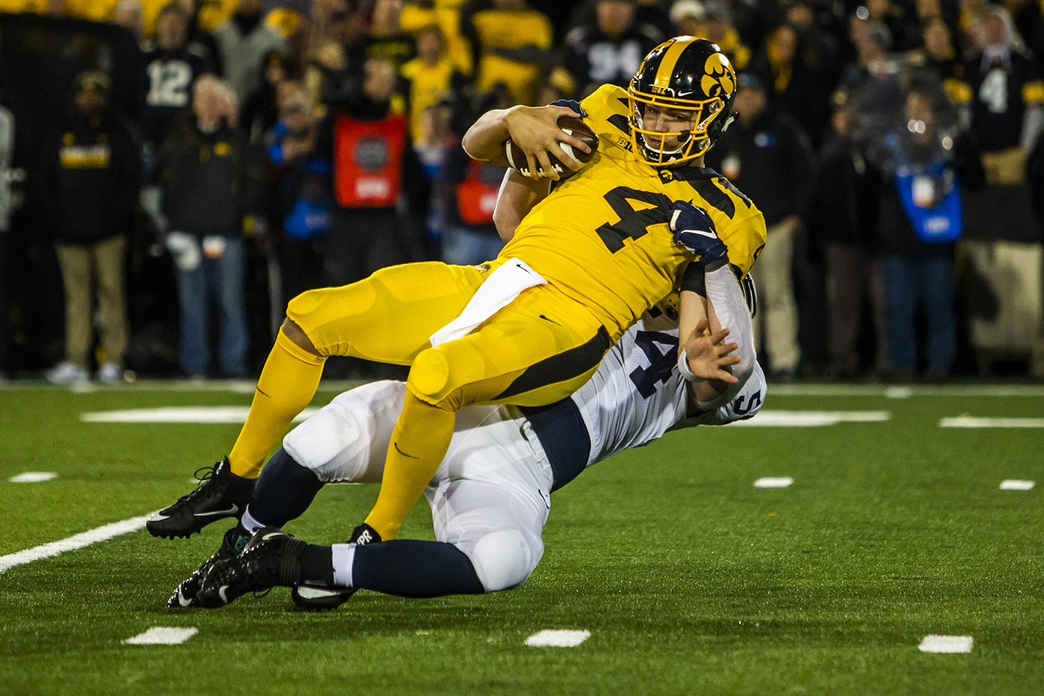 Iowa quarterback Nate Stanley is tackled during the Iowa football game against Penn State in Iowa City on Saturday, Oct. 12, 2019. The Nittany Lions defeated the Hawkeyes 17-12. (Katina Zentz/The Daily Iowan)