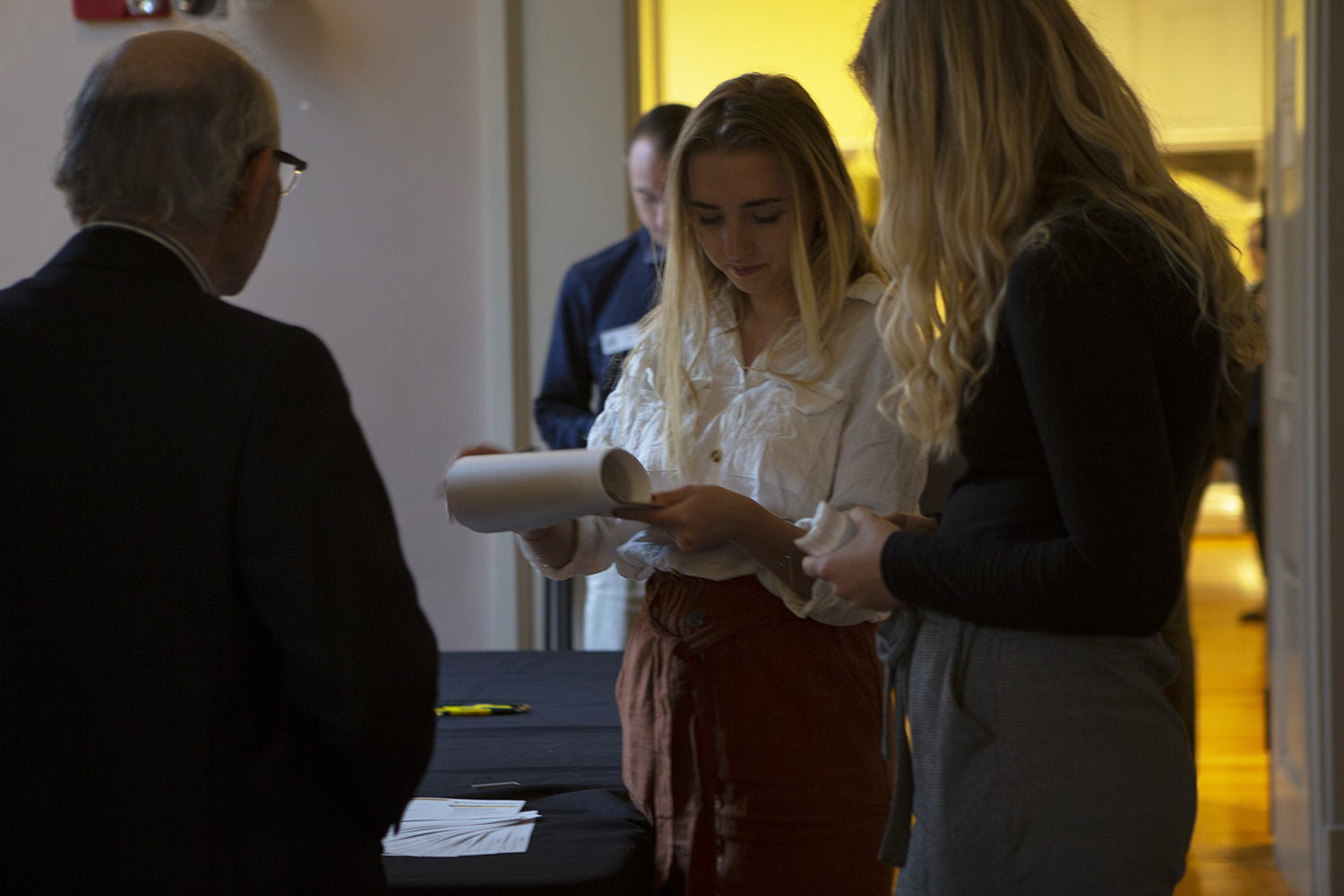Colleagues check in for the 20 years of Tippie celebration held at the Old Capitol Building on Thursday, October 10, 2019.