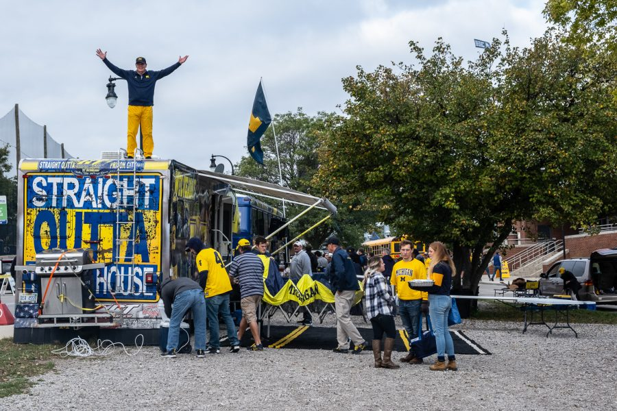 Fans+set+up+their+bus+to+tailgate+before+a+football+game+between+Iowa+and+Michigan+at+the+Michigan+Stadium+in+Ann+Arbor%2C+Michigan+on+Saturday%2C+October+5%2C+2019.+The+Wolverines+defeated+the+Hawkeyes+10-3.