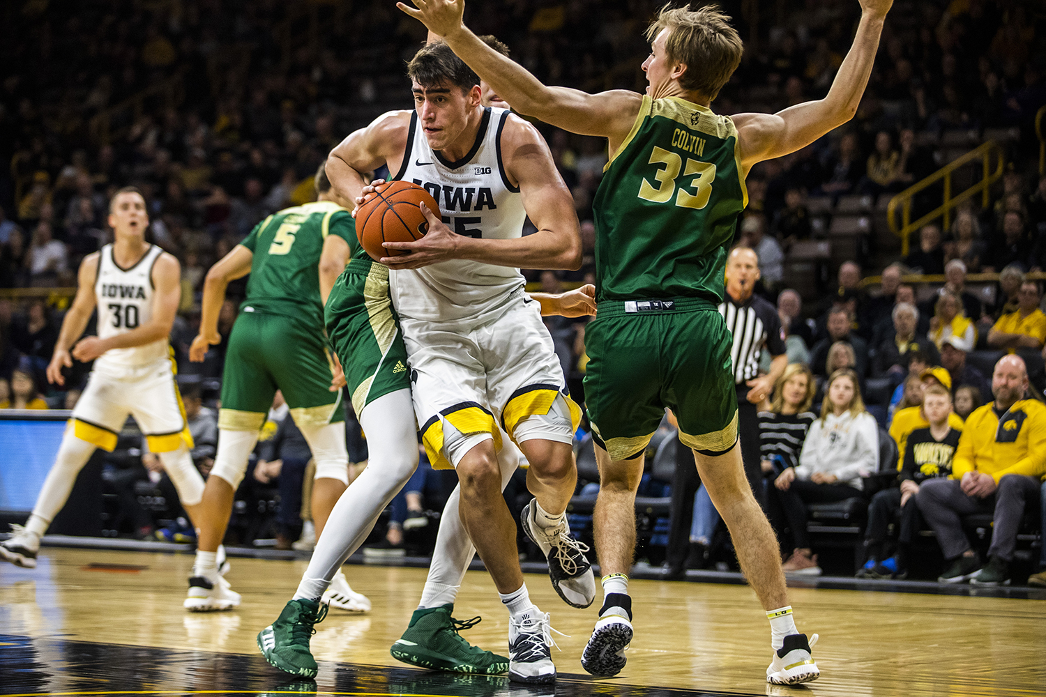 Iowa center Luka Garza drives the ball during the men's basketball game against Cal Poly at Carver-Hawkeye Arena on Sunday, November 24, 2019. The Hawkeyes defeated the Mustangs 85-59. Garza made 8 of his 13 baskets.