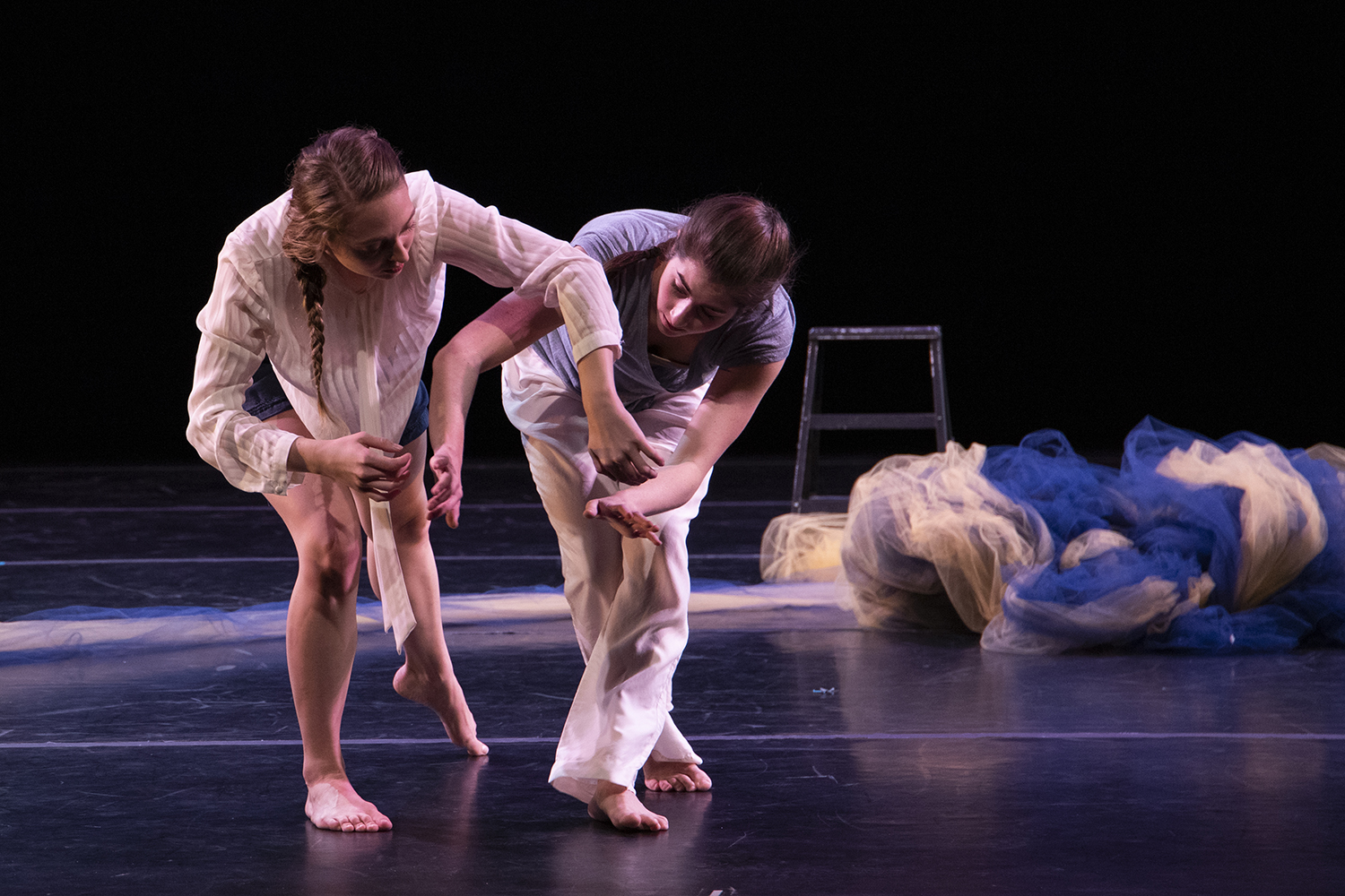 """Juliet Remmers and Kate Vincek perform """"Eternal Somewhere Else"""" during a dress rehearsal of  Words Dance at Space Place Theater on Friday, Nov. 1, 2019. The piece is underscored by sounds of Jupiter and Pluto as well as poetry by Manuel Beccerra."""