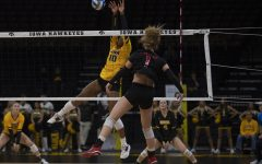 Iowa outside hitter Griere Hughes blocks the ball during a volleyball game between Iowa and Rutgers at the Carver Hawkeye Arena on Nov. 2, 2019. The Hawkeyes fell to the Scarlet Knights, 0-3.