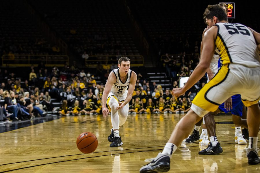 Iowa+guard+CJ+Fredrick+passes+the+ball+during+the+men%27s+basketball+game+against+Lindsey+Wilson+College+at+Carver-Hawkeye+Arena+on+Monday%2C+November+4%2C+2019.+The+Hawkeyes+defeated+the+Blue+Raiders+96-58.