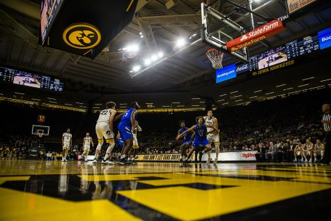 Players prepare to rebound the ball during the men's basketball game against Lindsey Wilson College at Carver-Hawkeye Arena on Monday, November 4, 2019. The Hawkeyes defeated the Blue Raiders 96-58.