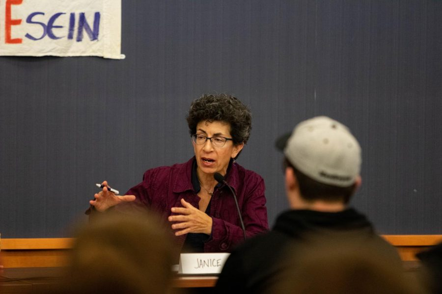 Former U.S. Diplomat Janice Weiner speaks about her experience living in Berlin when the wall came down during a forum at the Iowa City Public Library on Wednesday, November 6, 2019.