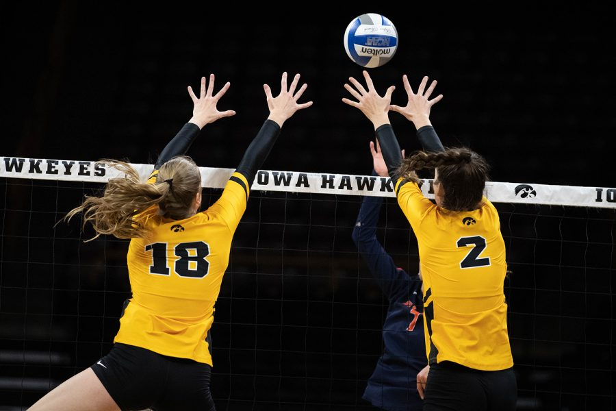 Iowa%27s+Hannah+Clayton+%2818%29+and+Courtney+Buzzerio+block+a+spike+during+a+match+against+the+University+of+Illinois+on+Wednesday%2C+Nov.+6%2C+2019.+The+Hawkeyes+lost+to+the+Fighting+Illini%2C+who+won+3-0.+Clayton+led+the+Hawkeyes+in+blocks+with+four+blocks.+