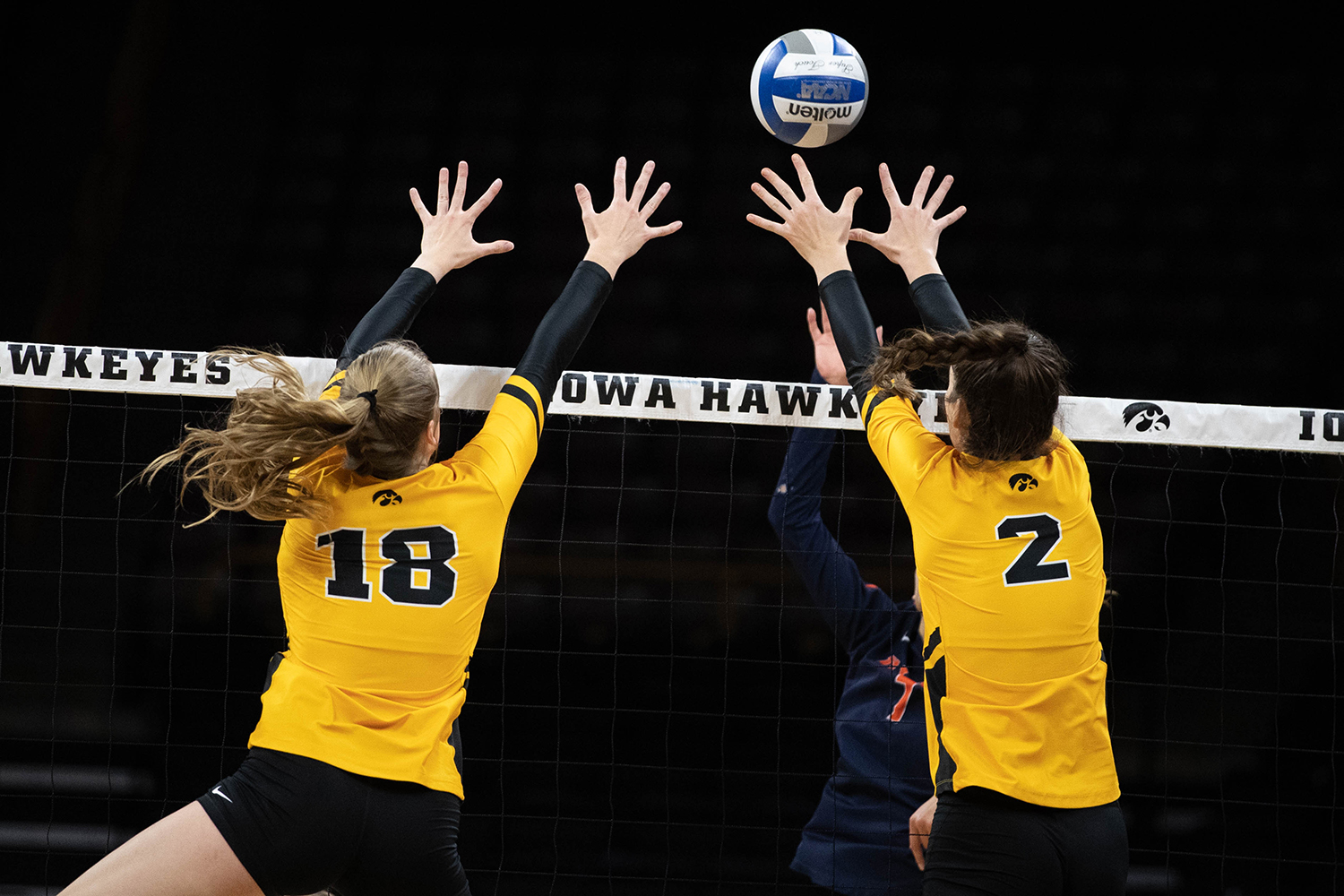 Iowa's Hannah Clayton (18) and Courtney Buzzerio block a spike during a match against the University of Illinois on Wednesday, Nov. 6, 2019. The Hawkeyes lost to the Fighting Illini, who won 3-0. Clayton led the Hawkeyes in blocks with four blocks.