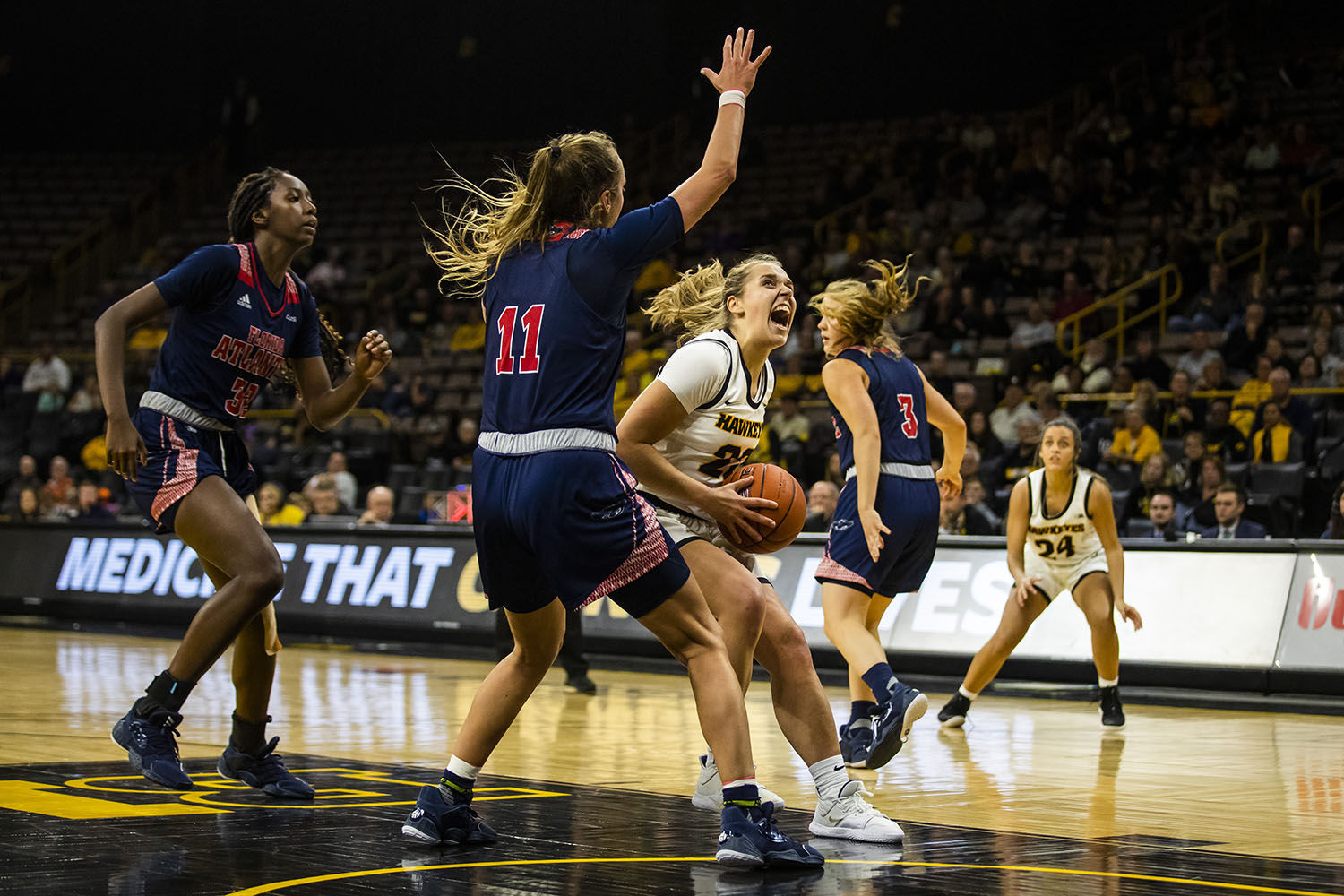 Iowa guard Kathleen Doyle drives the ball during the women's basketball game against Florida Atlantic on Thursday, November 7, 2019. The Hawkeyes defeated the Owls 85-53.
