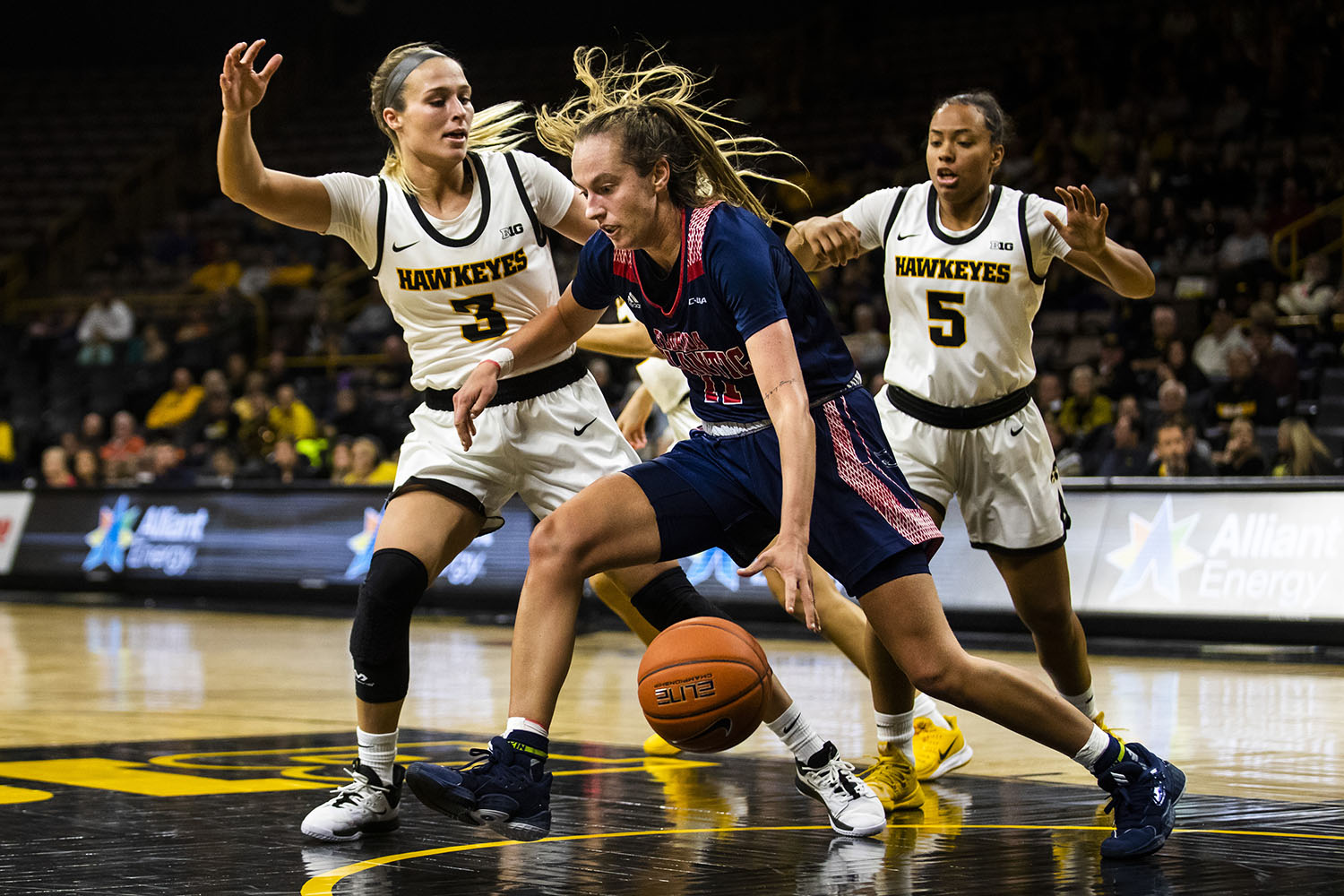Iowa guard Makenzie Meyer guards Florida Atlantic forward Juliette Gauthier during the women's basketball game against Florida Atlantic on Thursday. The Hawkeyes defeated the Owls 85-53.