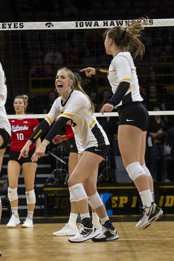 Middle+blocker+Hannah+Clayton+celebrates+after+her+team+scores+a+point+against+the+Huskers.+The+Huskers+defeated+the+Hawkeyes+in+three+sets+on+November+9%2C+2019%2C+at+Carver-Hawkeye+Arena.+