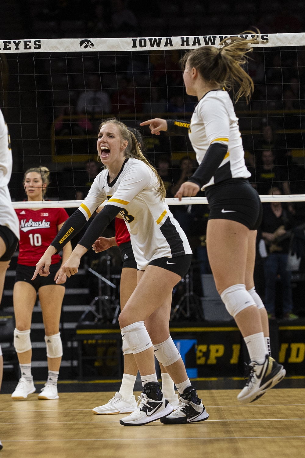 Middle blocker Hannah Clayton celebrates after her team scores a point against the Huskers. The Huskers defeated the Hawkeyes in three sets on November 9, 2019, at Carver-Hawkeye Arena.