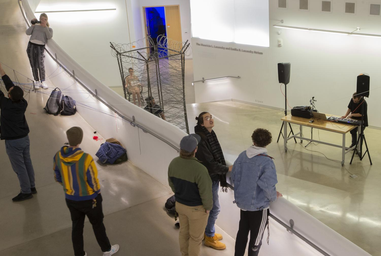 Attendees observes an art pieces at the Intermedia Open House on Thursday, Nov. 14, 2019. The Open Hose features 48 participants, 28 of who were intermedia undergraduate students. (Hayden Froehlich/The Daily Iowan)