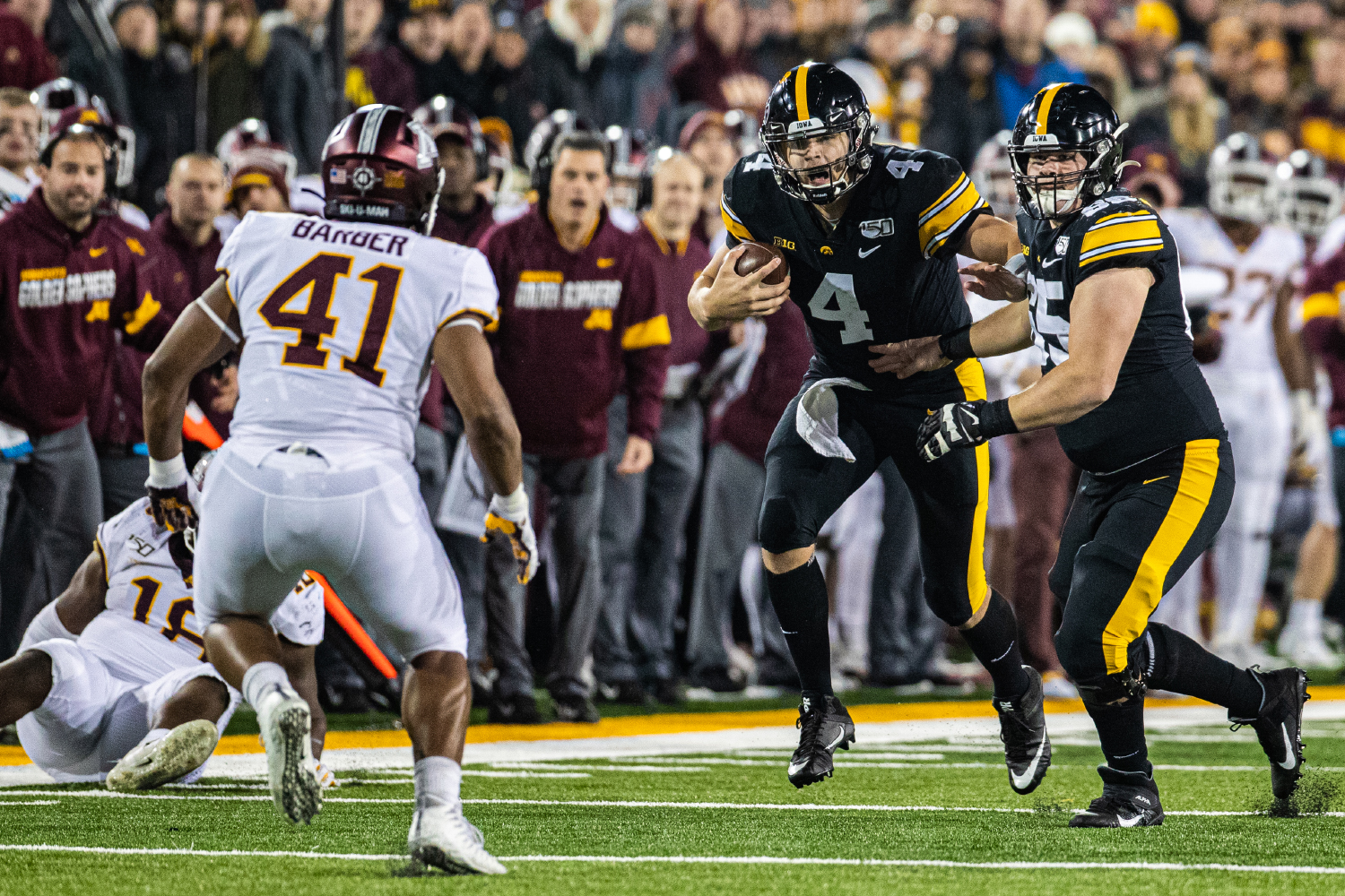 Iowa quarterback Nate Stanley carries the ball during a football game between Iowa and Minnesota at Kinnick Stadium on Saturday, Nov. 16, 2019. The Hawkeyes defeated the Gophers, 23-19. (Shivansh Ahuja/The Daily Iowan)