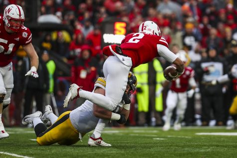 Iowa defensive lineman Brady Reiff tackles Nebraska quarterback Adrian Martinez during the football game against Nebraska at Memorial Stadium on Friday, November 29, 2019. The Hawkeyes defeated the Cornhuskers 27-24. Martinez rushed a total of 44 yards.