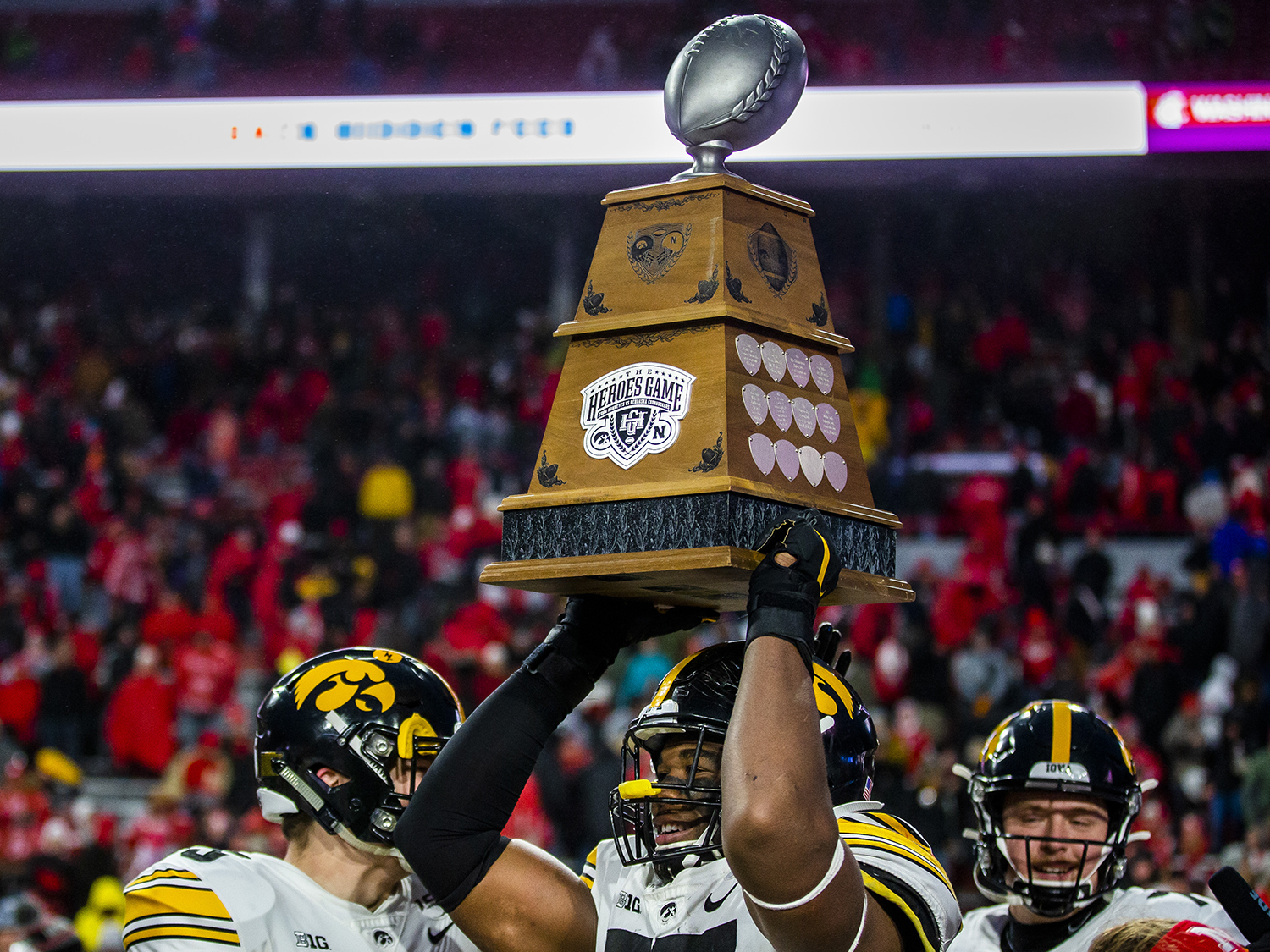 Iowa defensive lineman Chauncey Golston carries the Heroes Trophy after the football game against Nebraska at Memorial Stadium on Friday, November 29, 2019. The Hawkeyes defeated the Cornhuskers, 27-24.