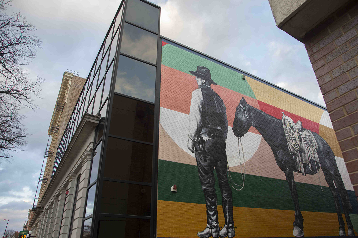 A mural by Thomas Agran depicting Ben S. Summerwill is seen on the wall of the MidwestOne Bank in downtown Iowa City on Tuesday, 19 November, 2019.
