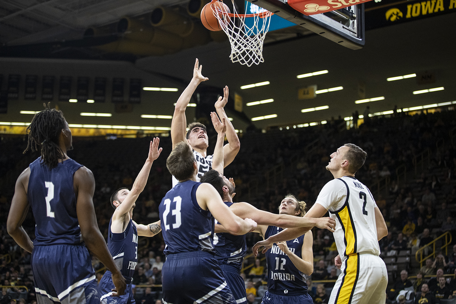 Center Luka Garza attempts a basket during the Iowa Men's basketball game vs University of North Florida in Carver-Hawkeye Arena on Thursday Nov. 21, 2019. The Hawkeyes defeated the Osprey 83-68.