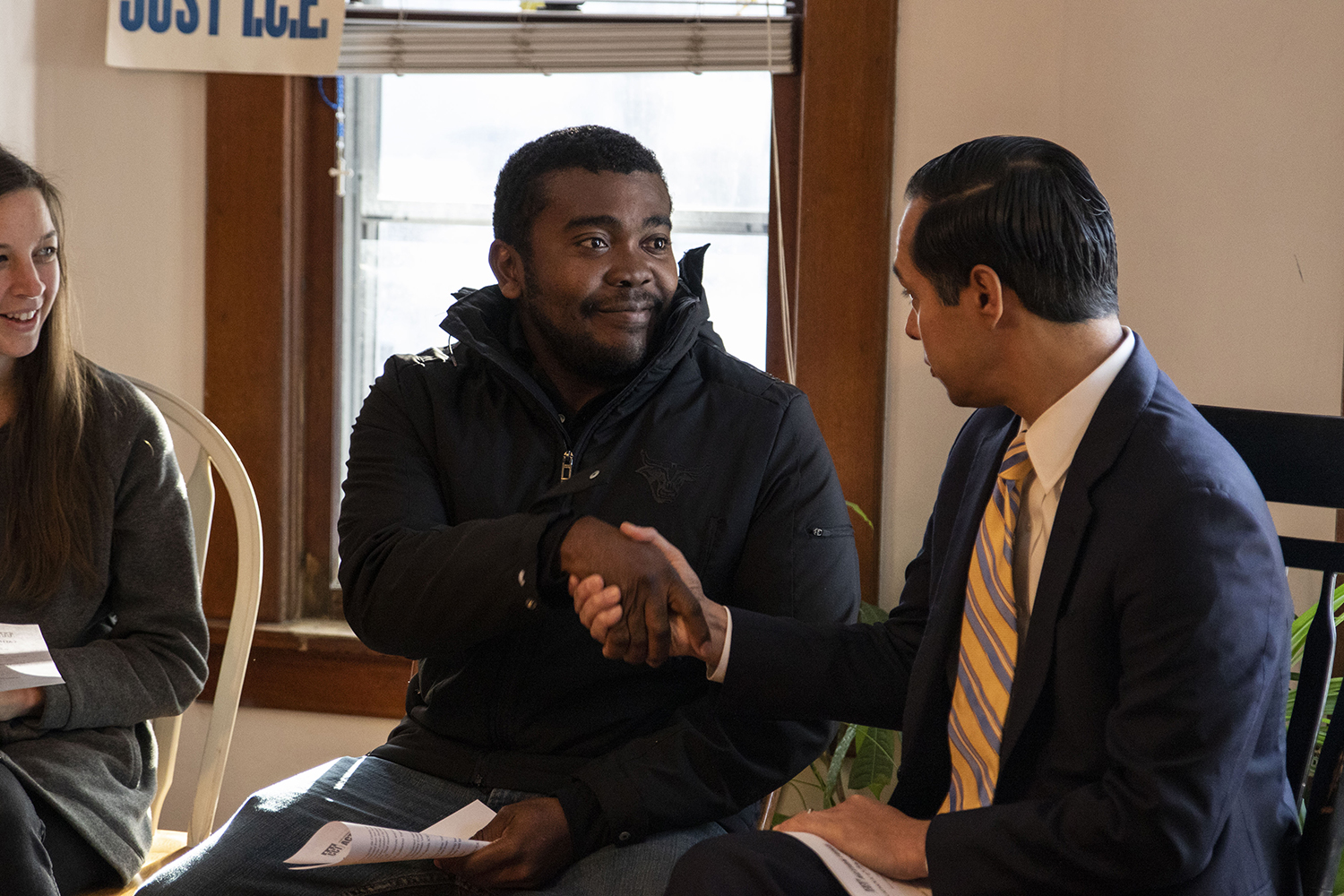 José Robinson Palacios shakes hands with Former Secretary of Housing and Urban Development Julián Castro at a meet and greet with the Catholic Worker House in Iowa City on Tuesday, Nov. 12, 2019. Castro met with families of immigrants to listen to their stories and discuss ICE. Palacios is a Honduran refugee.
