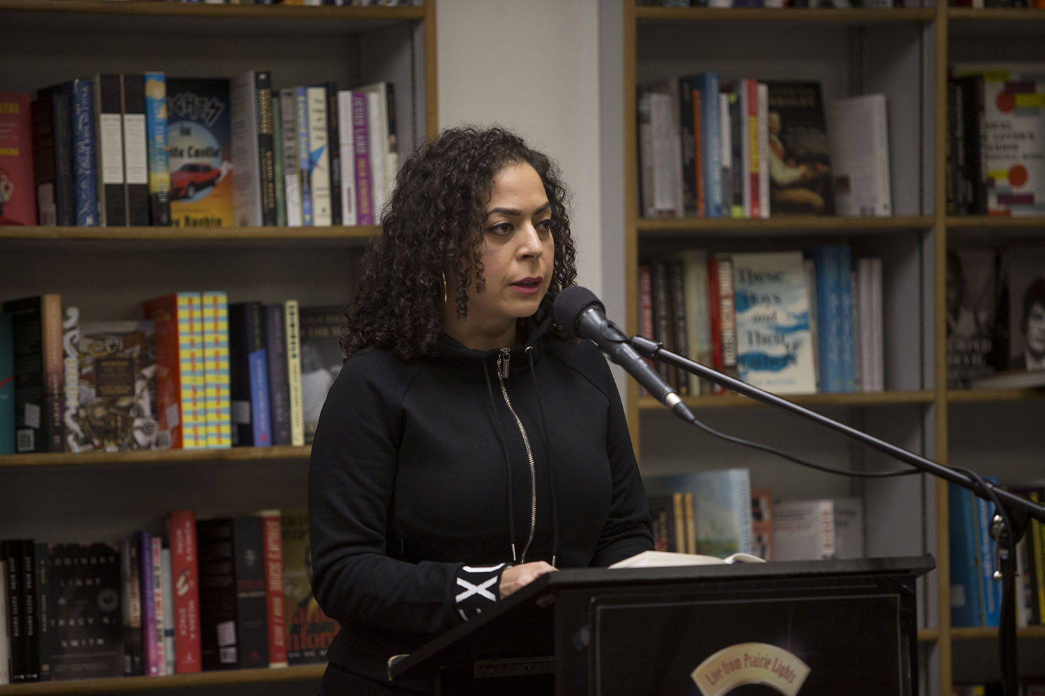 Author Jaquira Díaz reads from her memoir, Ordinary Girls, during a Live From Prairie Lights event on Tuesday, Nov. 5, 2019. Ordinary Girls details her life growing up in Puerto Rico and Miami Beach and the struggles she faced. Díaz is the recipient of a variety of fellowships and awards for her work and is currently a Visiting Assistant Professor at the University of Wisconsin-Madison's MFA program in Creative Writing.