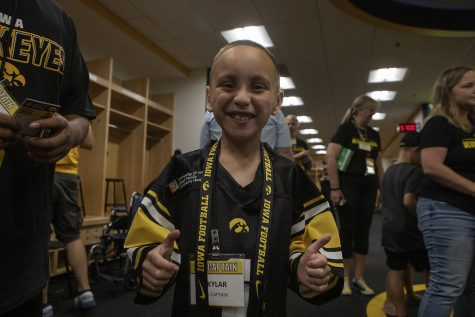 Kid Captain Skylar Hardee signals a thumbs up in the Hawkeye football locker room at Kids Day at Kinnick on Saturday, August 10, 2019. Kids Day at Kinnick is an annual event for families to experience Iowa