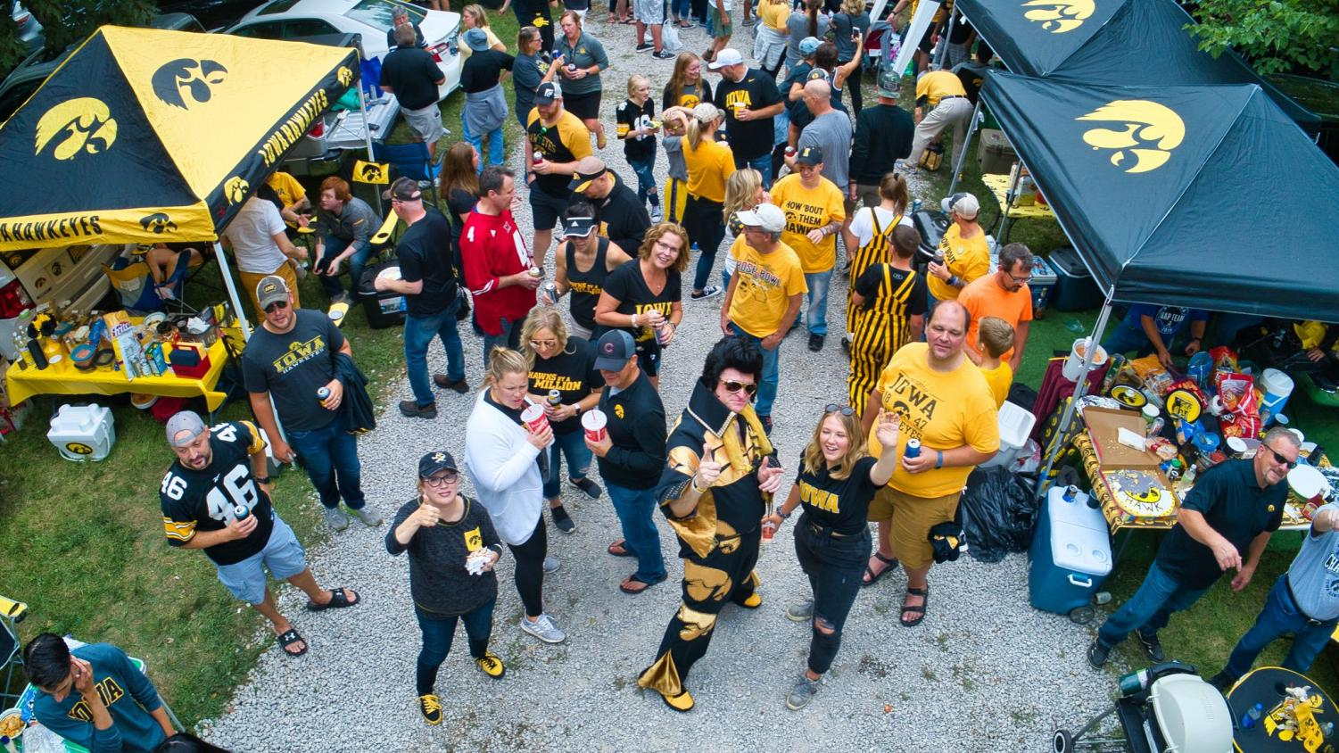 Greg Suckow, known as Hawkeye Elvis, tailgates with friends he met through Twitter.
