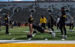 Iowa Strength and Conditioning coach Chris Doyle coaches during warm up drills before the game against Illinois on Saturday, November 23, 2019. The Hawkeyes defeated the Fighting Illini 19-10.