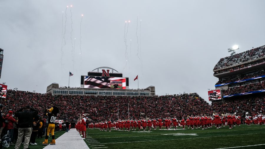 The+University+of+Nebraska+Marching+Band+performs+before+the+game+against+Nebraska+on+Friday%2C+November+29%2C+2019.+The+Hawkeyes+defeated+the+Corn+Huskers+27-24.+