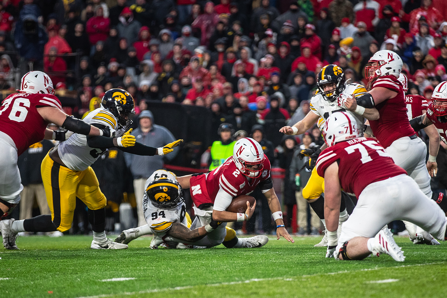 Nebraska quarter back Adrian Martinez is tackled by Iowa defensive end A.J. Epenesa during the game against Nebraska on Friday, November 29, 2019. Epenesa lead the Hawkeyes with nine solo tackles and five assisted. The Hawkeyes defeated the Corn Huskers 27-24.
