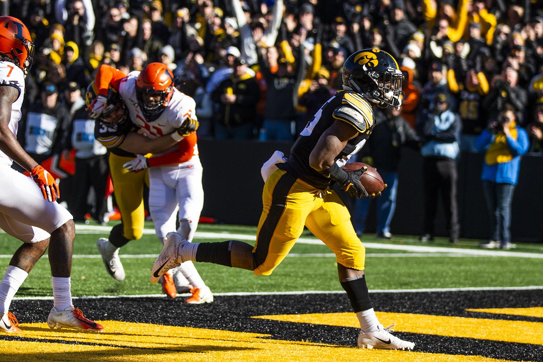 Iowa running back Tyler Goodson scores a touchdown during the football game against Illinois on Saturday, November 23, 2019.  (Katina Zentz/The Daily Iowan)