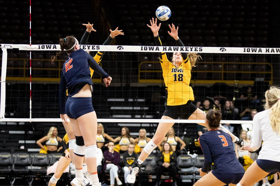 Iowas Hannah Clayton blocks a spike from Illinois Ashlyn Fleming during a match University of Illinois on Wednesday, Nov. 6, 2019. The Hawkeyes lost to the Fighting Illini, who won 3-0. (Emily Wangen/The Daily Iowan)