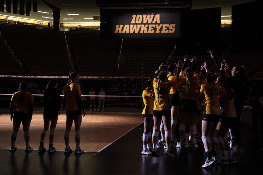 Members+of+the+starting+line+up+stand+next+to+the+Iowa+volleyball+team+during+introductions+before+a+volleyball+match+between+the+University+of+Iowa+and+Ohio+State+University+at+Carver+Hawkeye+Arena+on+Friday%2C+November+29%2C+2019.+The+Buckeyes+defeated+the+Hawkeyes+3-1.