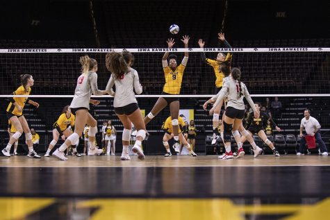 Iowa middle blocker Amiya Jones and Iowa outside hitter Edina Schmidt prepare to block the ball during a volleyball match between the University of Iowa and Ohio State University at Carver Hawkeye Arena on Friday, November 29, 2019. The Buckeyes defeated the Hawkeyes 3-1.
