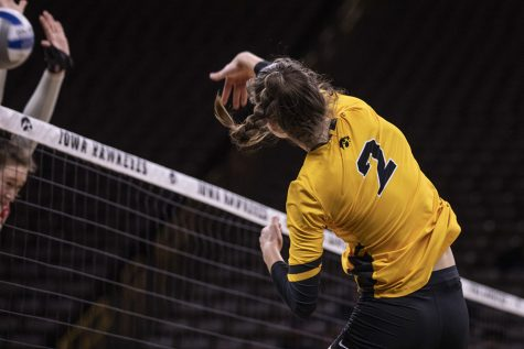 Iowa outside hitter Courtney Buzzerio spikes a ball towards the Ohio side of the net during a volleyball match between the University of Iowa and Ohio State University at Carver Hawkeye Arena on Friday, November 29, 2019. The Buckeyes defeated the Hawkeyes 3-1.
