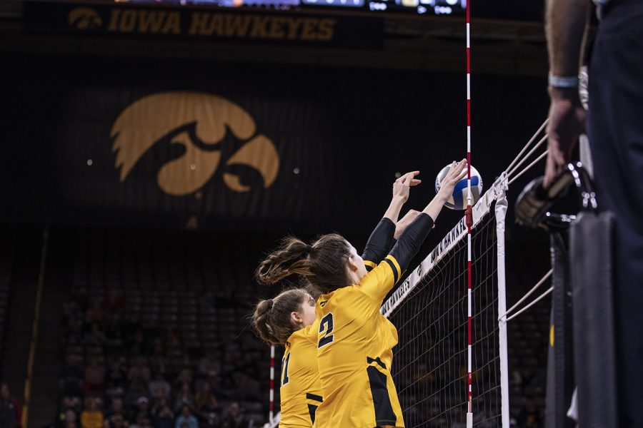 Iowa outside hitter Courtney Buzzerio and Iowa middle blocker Blythe Rients block a spike during a volleyball match between the University of Iowa and Ohio State University at Carver Hawkeye Arena on Friday, November 29, 2019. The Buckeyes defeated the Hawkeyes 3-1.