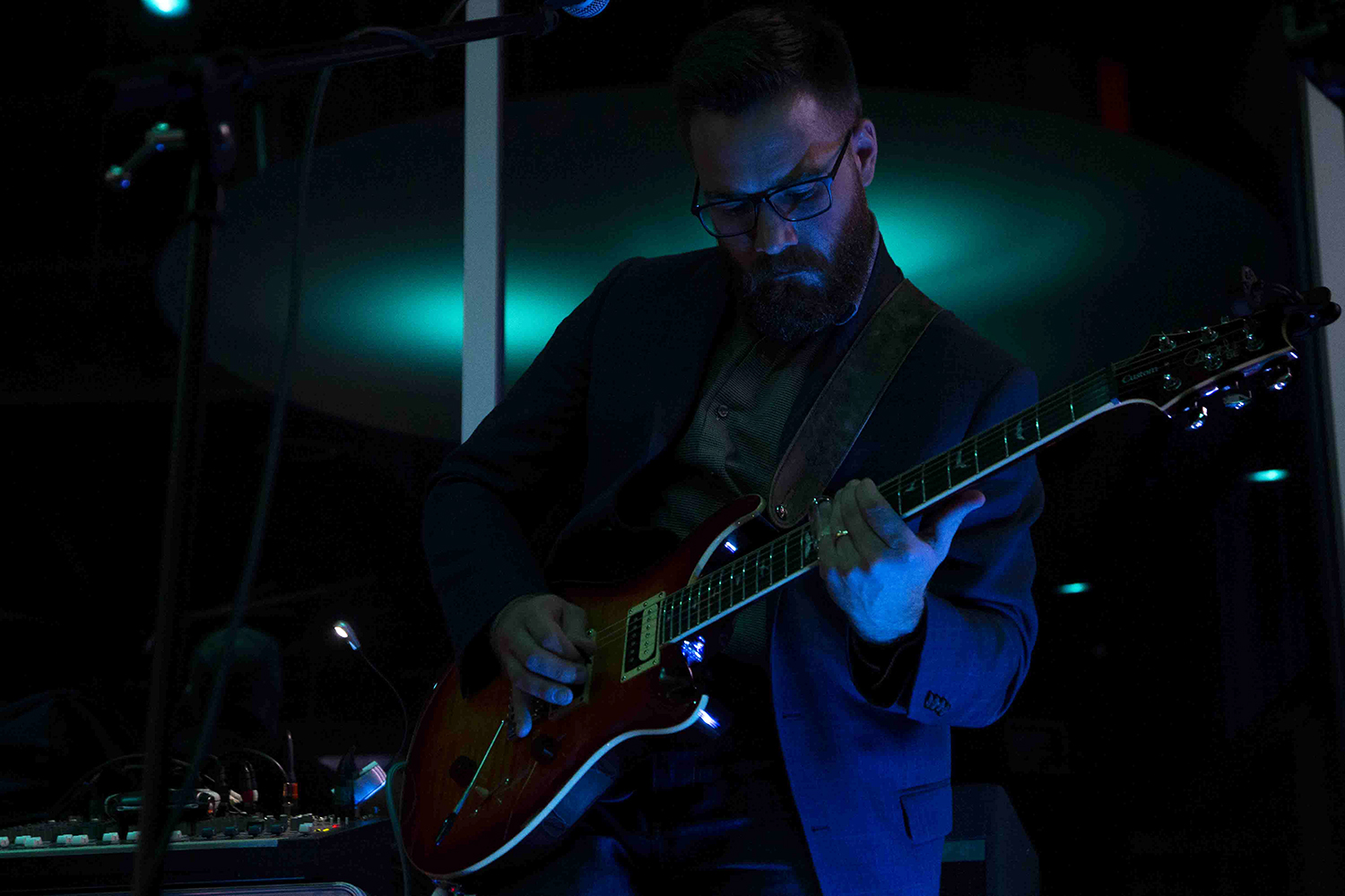 "Musician Micah Goebel plays the guitar during a performance by the band Vintage at the Vue Rooftop on Saturday, Nov. 16, 2019. Vintage regularly plays American classic rock hits including ""Brown Eyed Girl"" by Van Morrison and ""Take it Easy"" by The Eagles."