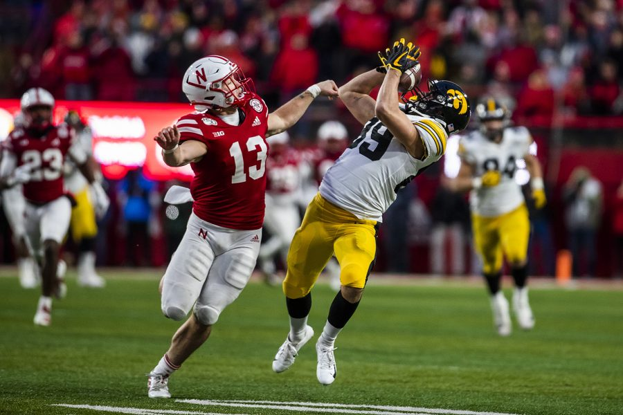 Iowa wide receiver Nico Ragaini catches a pass during the football game against Nebraska at Memorial Stadium on Friday, November 29, 2019. The Hawkeyes defeated the Cornhuskers 27-24. (Katina Zentz/The Daily Iowan)