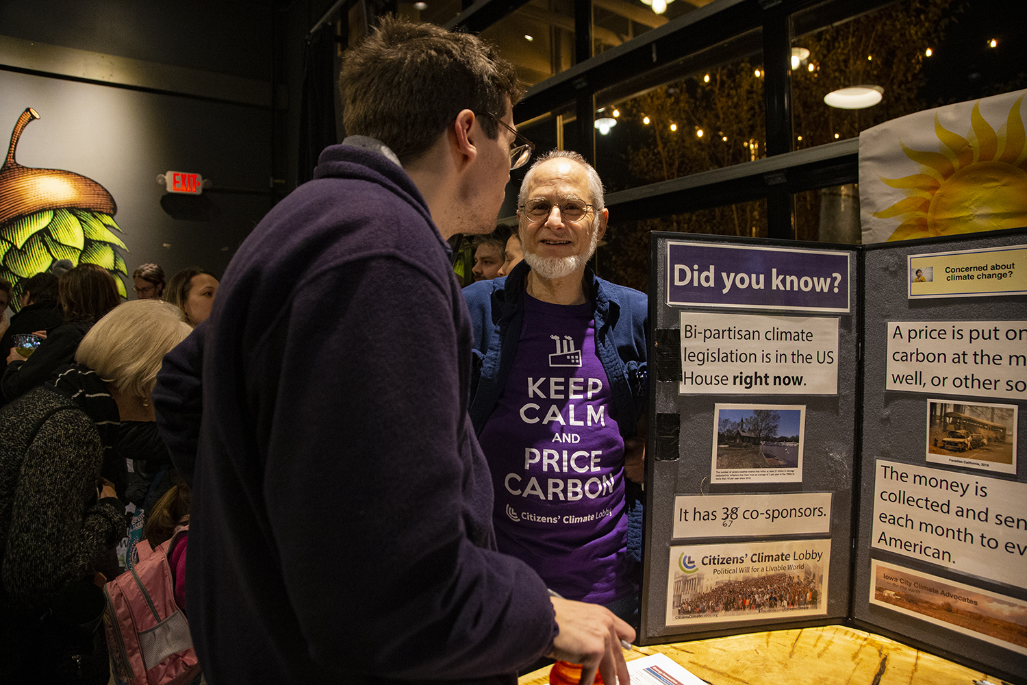 Members of the Citizen's Climate Lobby discuss local solutions to climate change. The first-of-its-kind Climate Action event took place at Big Grove Brewery on Nov. 21.