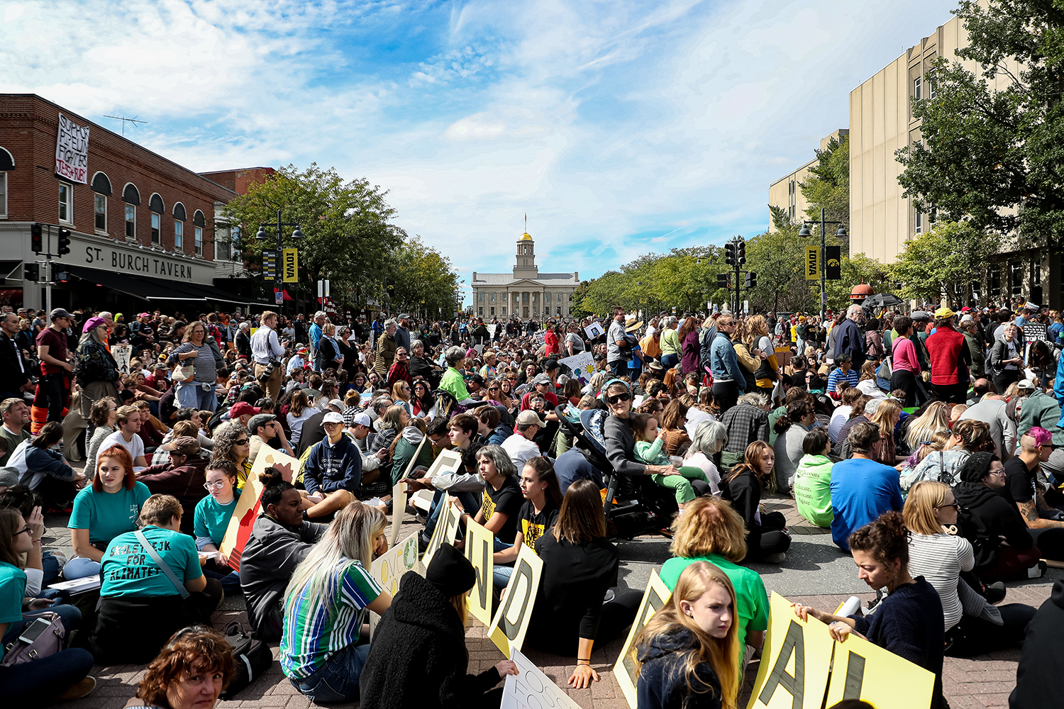 Protesters take part in an 11-minutes sit-down protest during the Iowa City Climate Strike in downtown Iowa City on Friday, Oct. 4, 2019. (David Harmantas/For The Daily Iowan)