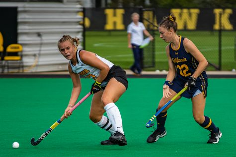 Iowa midfielder Katie Birch looks to pass during a field hockey match between Iowa and California on Friday, September 13, 2019. The Hawkeyes defeated the Bears, 4-2.