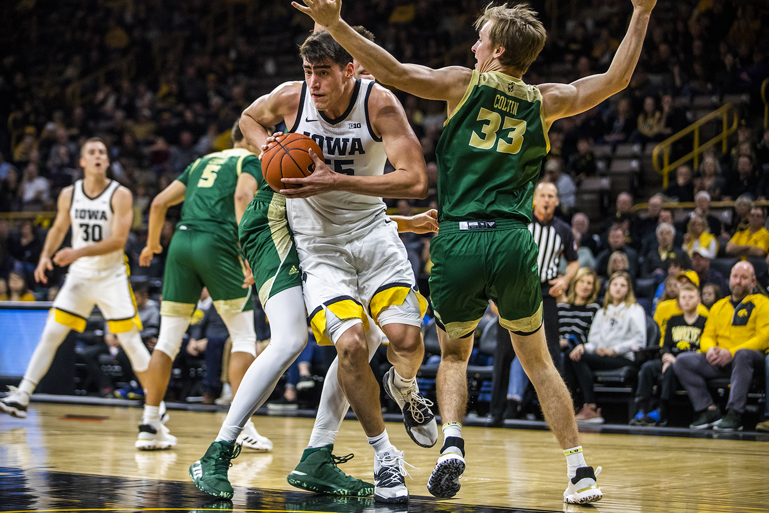 Iowa center Luka Garza drives the ball during the men's basketball game against Cal Poly at Carver-Hawkeye Arena on Sunday, November 24, 2019.