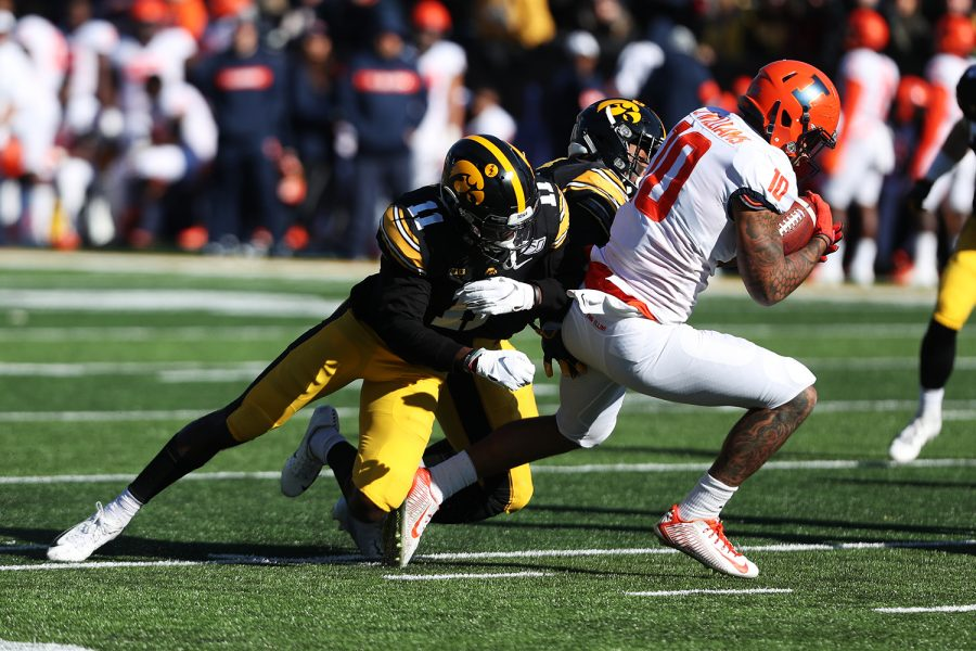 Iowa defensive back Michael Ojemudia prepares for a tackle during the football game against Illinois on Saturday, November 23, 2019.