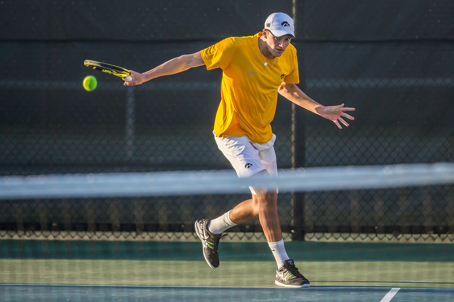 Iowa's Joe Tyler hits a backhand during a men's tennis match between Iowa and Michigan State at the Hawkeye Tennis Recreation Complex  on Friday, April 19, 2019. The Hawkeyes defeated the Spartans, 5-2. (Shivansh Ahuja/The Daily Iowan)