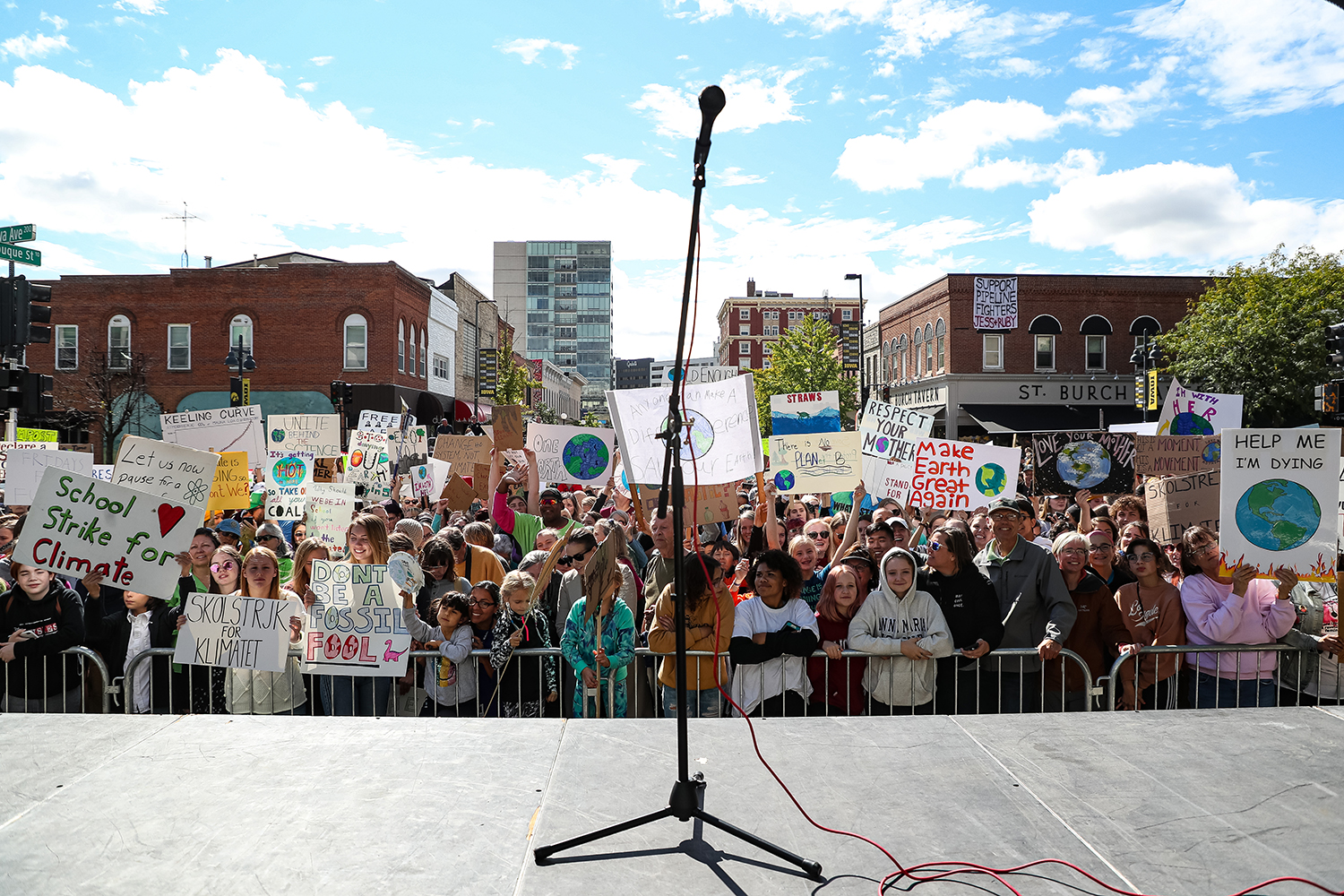 Protestors crowd in front of the stage to hear Swedish climate activist Greta Thunberg speak at the Iowa City Climate Strike in downtown Iowa City on Friday, Oct. 4, 2019. (David Harmantas/For The Daily Iowan)