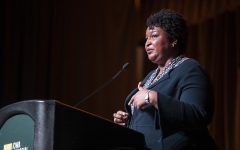 Fair Fight Founder Stacey Abrams addresses the crowd at the IMU on Monday, Nov. 4, 2019. Abrams spoke on the 100th commencement of the 19th amendment. (Katie Goodale/The Daily Iowan)