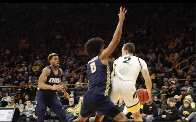 Iowa+forward+Jack+Nunge+keeps+the+ball+from+Oral+Roberts+forward+Kevin+Obanor+at+the+Iowa-Oral+Roberts+game+at+Carver-Hawkeye+Arena+on+Nov.+15.+The+Hawkeyes+won%2C+87-74.