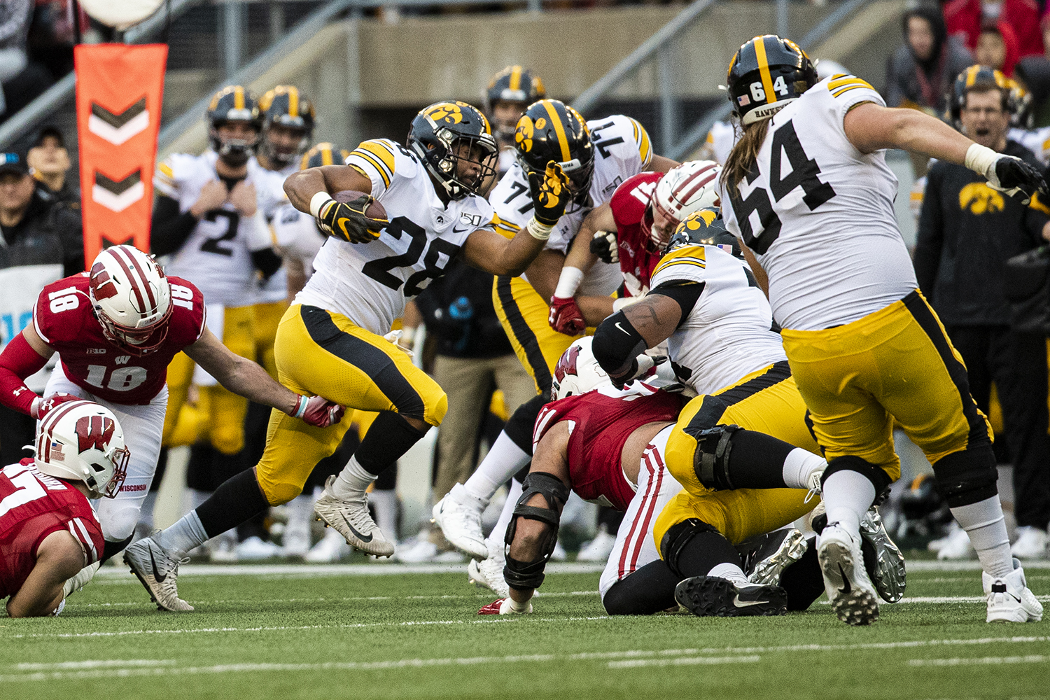 Iowa running back Toren Young carries the ball during a football game between Iowa and Wisconsin at Camp Randall Stadium in Madison on Saturday, November 9, 2019.