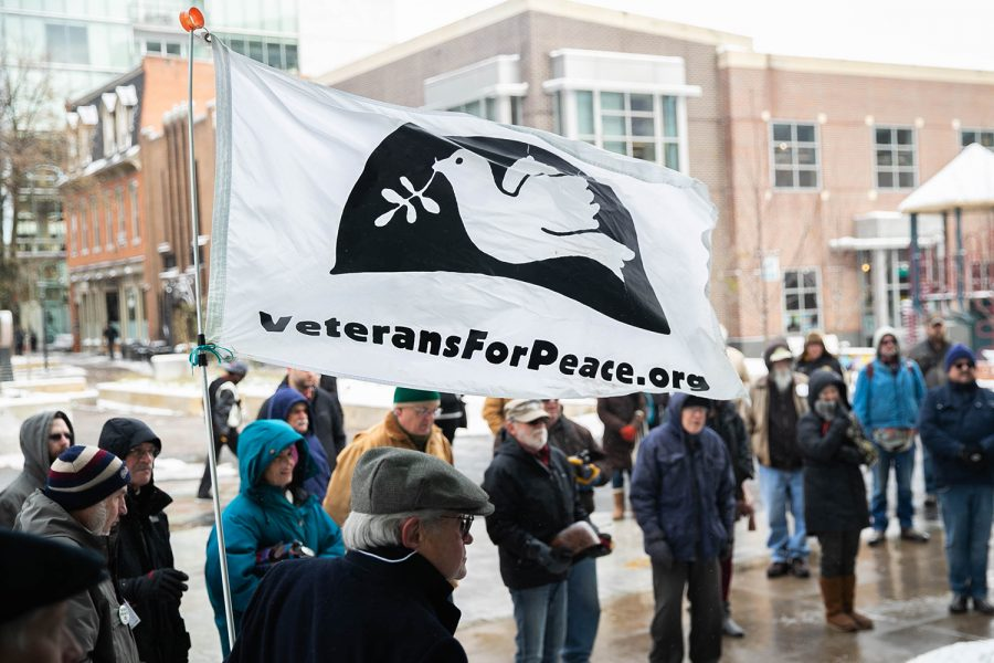 People attend a Veterans Day Rally at the Ped Mall on Monday, November 11, 2019.