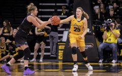 Iowa Forward Monika Czinano attempts to steal the ball during a Women's basketball exhibition game between the University of Iowa and Winona State University at Carver Hawkeye Arena on November 3, 2019. The Hawkeye's beat the Warrior's with a score of  98-53.