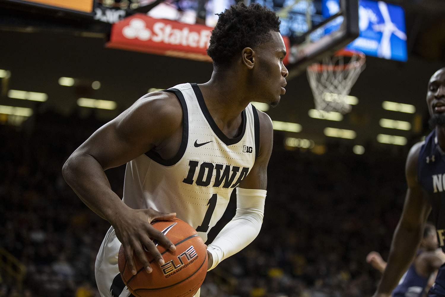 Iowa Guard Joe Toussaint throws the ball back into play during the Iowa Men's basketball game vs The University of North Florida in Carver-Hawkeye Arena on Thursday, Nov. 21, 2019. The Hawkeyes defeated the Osprey 83-68.