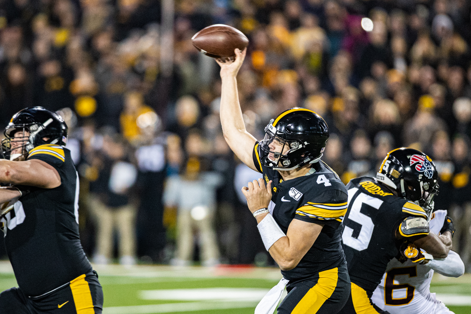 Iowa quarterback Nate Stanley makes a pass during a football game between Iowa and Minnesota at Kinnick Stadium on Saturday, Nov. 16, 2019. The Hawkeyes defeated the Gophers, 23-19. (Shivansh Ahuja/The Daily Iowan)
